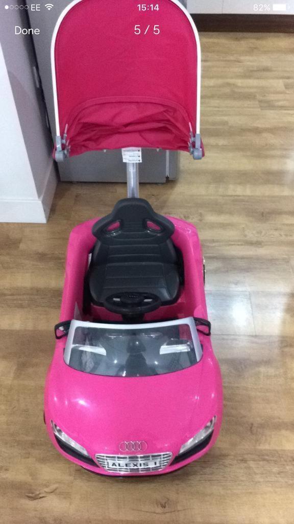 Kids pink Audi ride on car