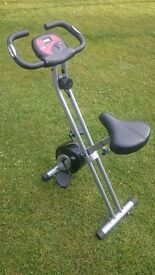 exercise bike , cross trainer , ab trimmer