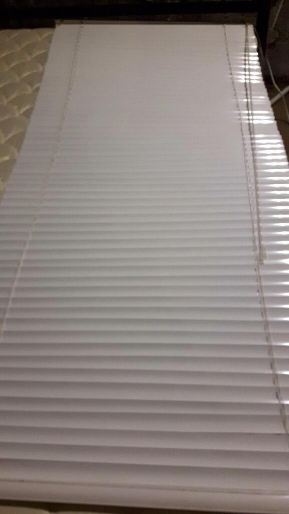 Aluminium white blinds.