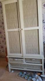 Wicker bedroom wardrobe with drawer.