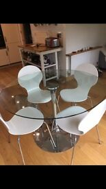 Glass & chrome round dining table & chairs