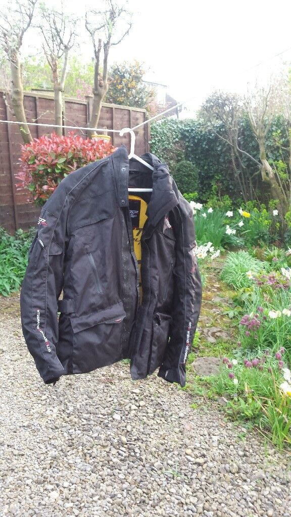 Motorcycle Jacket, trousers, helmet, boots and gloves