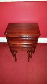 nest of 3 brown wood occasional tables