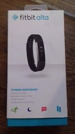 Brand new boxed fitbit alta fitness wristband black with box & charger cost £95 buy now £40