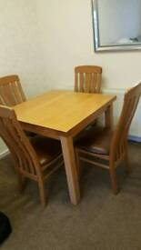 Oak table with for chairs