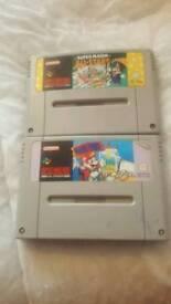 2 super Nintendo games Both mario games/ cash or swaps