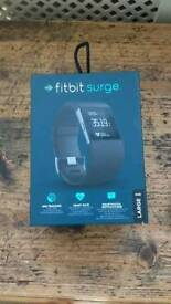 Two fitbit surge watches