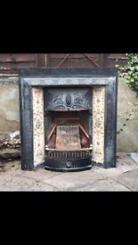 For Sale Victorian style cast iron fire surround with inset tiles 91cmWide x97cmHigh