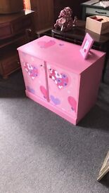 Pink storage cupboard FROM DRAB TO FAB