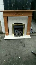 Fireplace surround. Gas fire. Stone hearth.