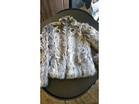 Faux fur jacket in size 8. With zip.