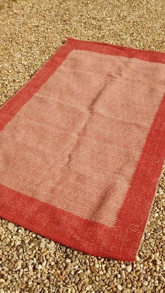 Natural brick and oatmeal colour rug as new.