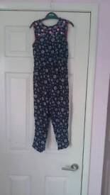 Girls size 4-5 navy ditsy flower jumpsuit with pink flower detail