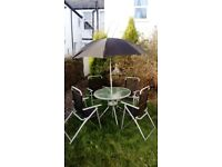 Garden table and 4 chairs in perfect condition