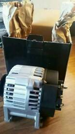 Brand New In Box 120amp Alternator. Right or left mounting.