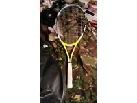 Dunlop tennis racket as new yellow in color with leather cade