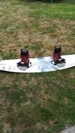 Liquid Force wake board with binding boots.