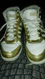 ADIDAS GOLD HIGH TOPS.