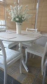 Shabby chic dining table with gate leg and detail complete with 4 upholystered chair in L grey white