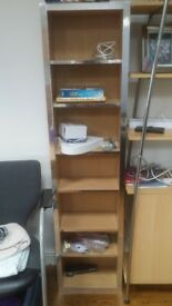 Tall standing shelf with chrome/mirror edging (bookshelf/cd and dvd rack/or any othwr purpose)