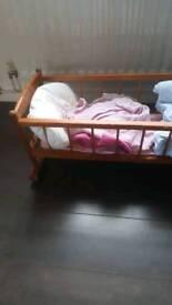 Dolls rocking crib
