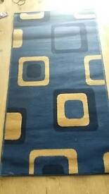 Square pattern blue Rug