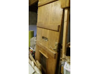Solid oak front door with small glass window