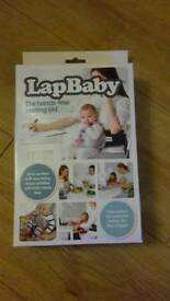 Lap baby hands free seating aid
