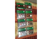 A JOB LOT OF COOKER SWITCHES WITH 13 AMP SOCKETS
