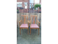 2 light wood framed carvery chair with pinky padded seats