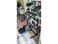 Alesis DM5 Electronic Drum Kit with Stool, Sticks and Amplified Speakers