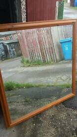 I metre square bevelled pine framed mirror..