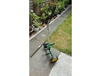 GARDEN / ALLOTMENT TROLLEY - ADJ TOP SUPPORT. WIDE PLASTIC WHEELS. AS NEW ONLY £15