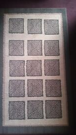 Rug. Modern pattern, jute backed. Good condition.