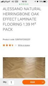 14 packs of herringbone effect laminate flooring
