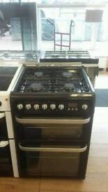 HOTPOINT BLACK 60CM WIDE DOUBLE OVEN FULL GAS COOKER WITH SAFETY GLASS LID