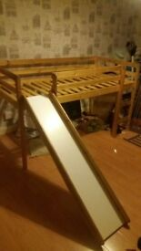 Cabin bed with slide