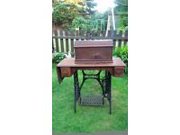 A Vintage Singer Antique Sewing Machine with table