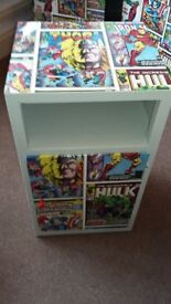 A bedroom cabinet decoupaged in Marvel
