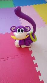 Toy chasing cheeky monkey