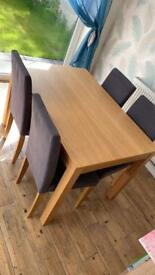 4 seater dining table complete with grey chairs