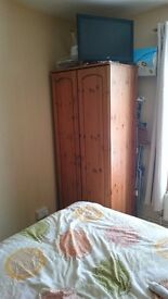 X2 PINE DOUBLE DOOR WARDROBES AND A 4 DRAWER CHEST