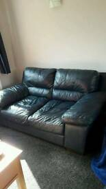 2 x large 2 seater dark blue leather sofas + puffy