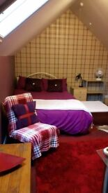 Very large room available in warm friendly house for full time working person