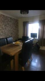 Old Creamery oak extending dining table & 6 leather chairs.