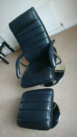 Black reclining chair and matching foot stool