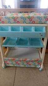 Baby changing unit with built in bath