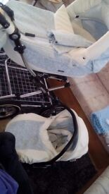 Beautiful baby blue with white leatherette travel system with a few extras pushchair seat also