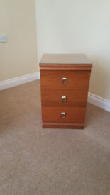 Solid wood teak bedside table with glass top