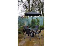 Black 4 chair garden dining set + parasol + base